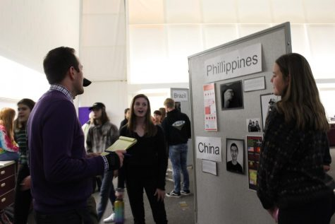 Students Taylor Hixson and Megan Stroik present at the Exhibition of Learning event on Dec. 4. Photo by Sadie Buggle